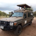 Wito Africa's safari vehicle and guests on Luxury African safari