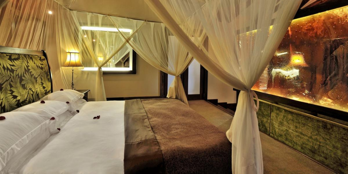 Arusha-Coffee-Lodge-Plantation-Suite-Bed